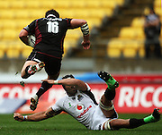 Harbour's James Hanson leaps over the tackle of Victor Vito.<br /> Air NZ Cup - Wellington Lions v North Harbour at Westpac Stadium, Wellington, New Zealand. Saturday 17 October 2009. Photo: Dave Lintott/PHOTOSPORT