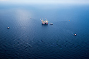 """Chevron's deepwater offshore oil platform """"JACK/ST. MALO"""" being positioned in the Gulf of Mexico by Crowley Maritime Corporation's OCEAN CLASS Tugs. (Aerial Photography by Tim Burdick)"""