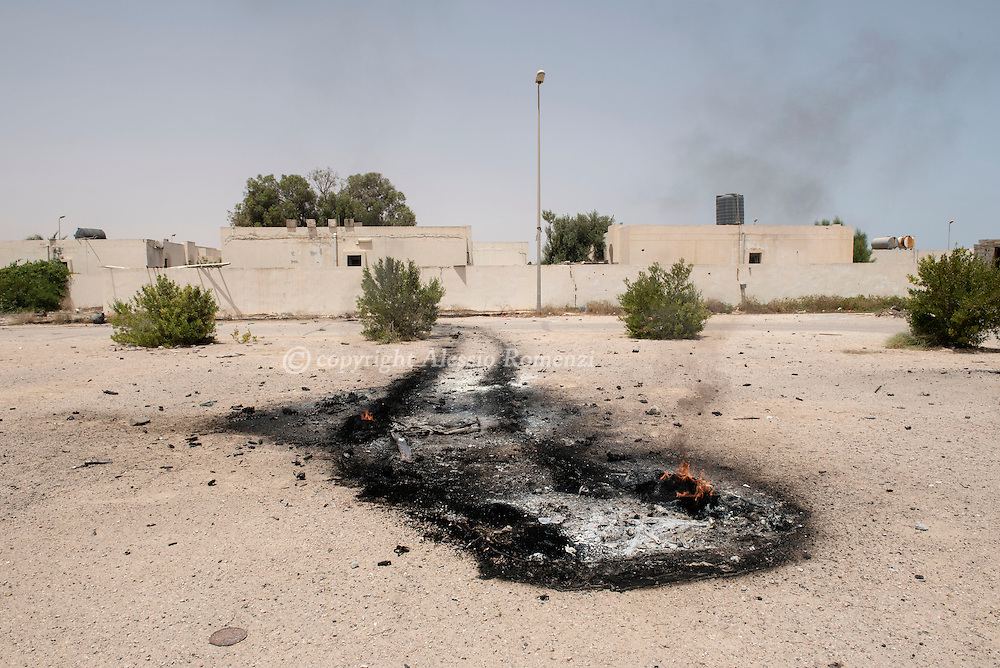 Libya: tace left by an ISIS destroyed car after being pulled away from the frontline between Libya's Government of National Accord's (GNA) forces and ISIS in Sirte. Alessio Romenzi