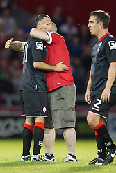 Image ©Licensed to i-Images Picture Agency. 07/08/2014. Salford, United Kingdom. Class of 92 Manchester. AJ Bell Stadium. Pitch invader hugs Ryan Giggs . Class of 92 squad play Salford City FC at the AJ Bell Stadium . Picture by i-Images