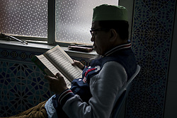 June 2, 2017 - Kuala Lumpur, Malaysia - A man recite the Holy Quran in a Mosque during the Holy month of ramadan at Malaysia , Ramadan the Holiest month on Islamic calendar , Muslims refrain from eating , drinking from dawn until sunset , 2 june 2017  (Credit Image: © Mustaqim Khairuddin/NurPhoto via ZUMA Press)