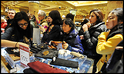 Shoppers look for bargains inside Harrods at the Harrods Christmas Sale begins today, Tuesday December 27, 2011. Photo By Andrew Parsons/i-Images