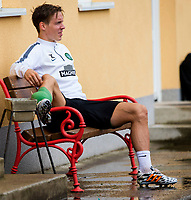 30/06/14<br /> CELTIC TRAINING<br /> AUSTRIA<br /> Celtic's Stefan Johansen is forced to sit down during training after picking up what seems to be a suspected injury.