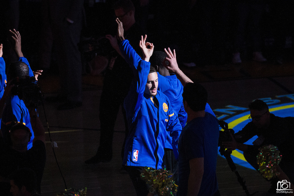 Golden State Warriors guard Klay Thompson (11) high fives teammates during pre-game ceremonies against the Los Angeles Lakers at Oracle Arena in Oakland, Calif., on November 23, 2016. (Stan Olszewski/Special to S.F. Examiner)