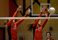 1 Nov. 2011 -- EDWARDSVILLE, Ill. -- Edwardsville High School girls' volleyball players Hannah Frierdich (12) and Camrey Saye (13) leap to block a spike attempt by Belleville West High School during the IHSA Class 4A girls volleyball sectional semifinal at Edwardsville High School in Edwardsville, Ill. Tuesday, Nov. 1, 2011. Edwardsville won, 2-1. Photo © copyright 2011 Sid Hastings.