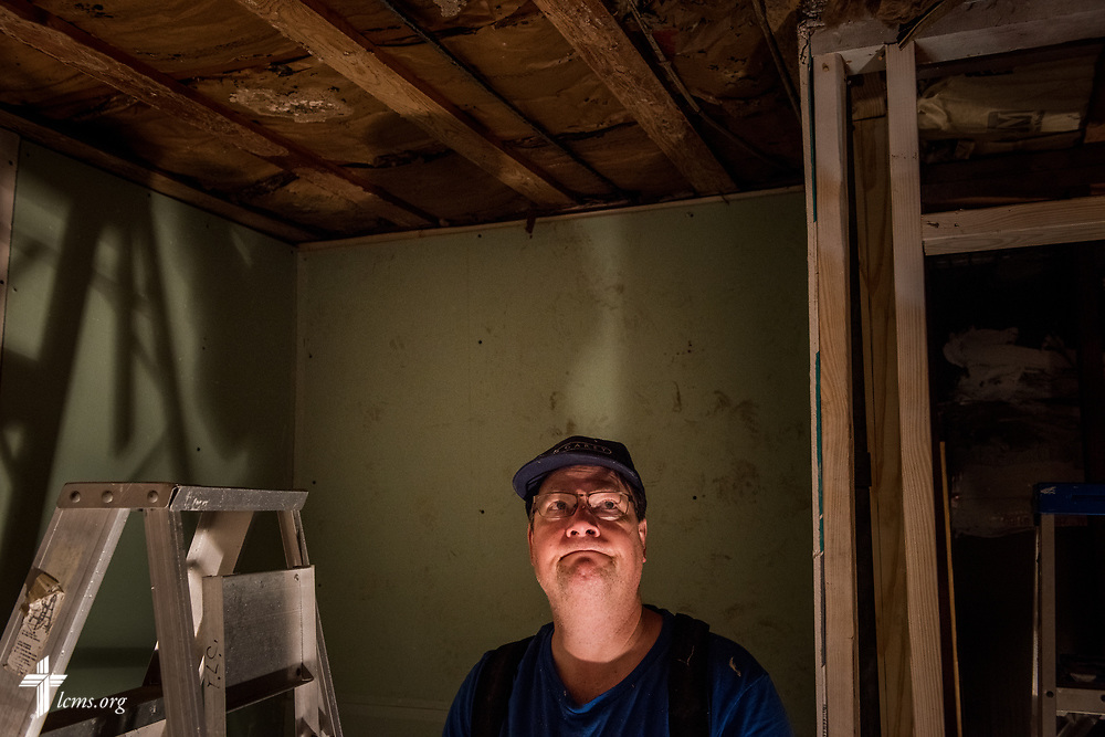 Bill Kearns, a volunteer from Saint Paul Lutheran Church, Mount Prospect, Ill., eyes a damaged ceiling in a church member's home on Wednesday, Feb. 7, 2018, in Port Arthur, Texas. Kearns was part of a team of volunteers rebuilding the home, which was severely damaged from Hurricane Harvey almost six months ago. LCMS Communications/Erik M. Lunsford