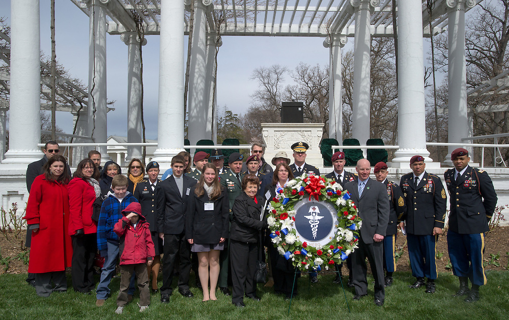 ARLINGTON, Virginia (March 28, 2011) -- A wreath laying at the Old Amphitheater in Arlington National Cemetery was conducted during a remembrance ceremony for family from around the country and for service members from all branches who gathered to honor 262 fallen medical service members who died in battle.  The Military Health System has hosted this event since 2009 and serves to bring families together who've lost loved ones that served as doctors, nurses, medics, corpsman and other medical personnel.  Photo by Johnny Bivera