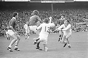 Galway keeper G Mitchell tries to get in a clearance despite the efforts of Cork's Jimmy Barry Murphy and D Barron of Cork during the All Ireland Senior Gaelic Football Championship Final Cork v Galway in Croke Park on the 23rd September 1973. Cork 3-17 Galway 2-13.