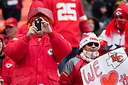 KANSAS CITY, MO - NOVEMBER 16:  Fans of the Kansas City Chiefs taking photos in the cold before a game against the Seattle Seahawks at Arrowhead Stadium on November 16, 2014 in Kansas City, Missouri.  The Chiefs defeated the Seahawks 24-20.  (Photo by Wesley Hitt/Getty Images) *** Local Caption ***