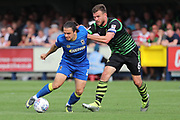 AFC Wimbledon attacker Egli Kaja (21) battles for possession with Doncaster Rovers defender Andy (Andrew) Butler (6) during the EFL Sky Bet League 1 match between AFC Wimbledon and Doncaster Rovers at the Cherry Red Records Stadium, Kingston, England on 26 August 2017. Photo by Matthew Redman.