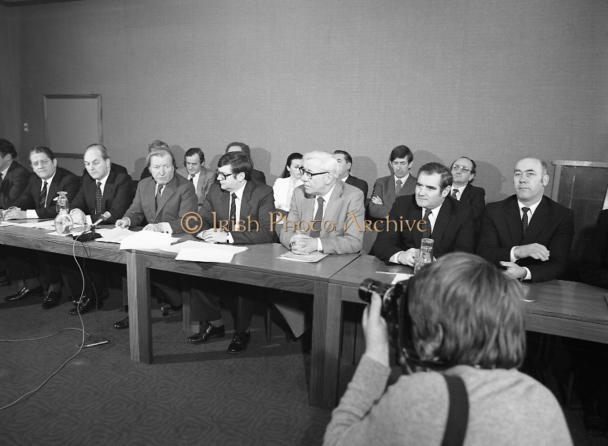 Fianna Fáil Front Bench at Press Conference January 1982..1982-01-14.14th January 1982..14/01/1982.01.14.82...Charles Haughey presents his front bench to the waiting media..Pictured at Leinster House..Front row From Left: ..Des O'Malley TD:.Spokeman on Industry and Commerce (partial)..Brian Lenihan TD:..George Colley TD: Deputy Leader and Spokesman on Energy..Charles Haughey TD: Leader of the Opposition..Ray Burke TD: Leader of the House..Sean Moore TD: Spokesman on Social Welfare..Gene Fitzgerald TD: Spokesman on Labour and Public Service..Martin O'Donoghue TD: Spokesman on Finance