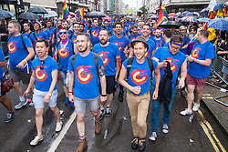 London, June 28th 2014. The London Gay Men's Chorus sings their way along the route as the Pride London parade proceeds through the city's streets.