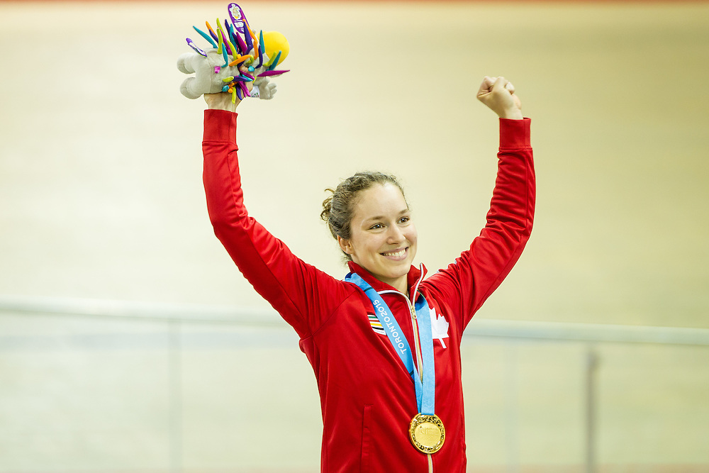 Gold medalist Monique  Sullivan of Canada waves to the crowd during the medal ceremony for the women's cycling sprint finals at the 2015 Pan American Games in Toronto, Canada, July 19,  2015.  AFP PHOTO/GEOFF ROBINS