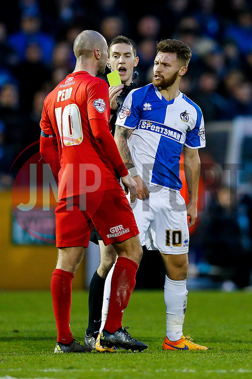 Matt Taylor of Bristol Rovers is confronted by Russell Penn of York City as he is shown a yellow card by referee Ben Toner - Mandatory byline: Rogan Thomson/JMP - 07966 386802 - 12/12/2015 - FOOTBALL - Memorial Stadium - Bristol, England - Bristol Rovers v York City - Sky Bet League 2.