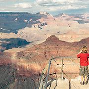 Editorial travel location photograph of grand canyon visitor in landscape photography
