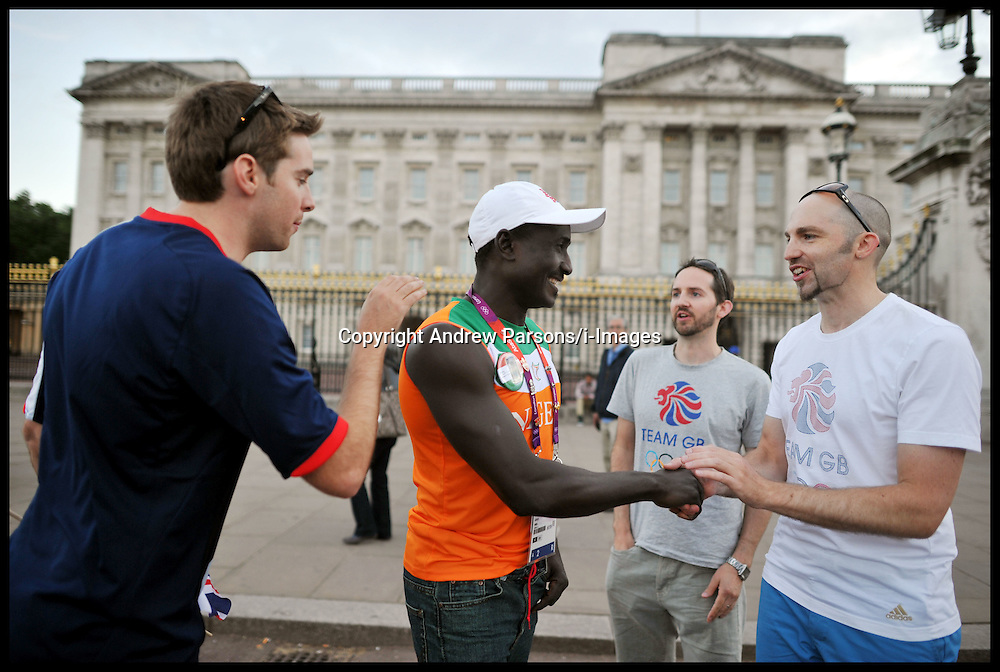 Olympic rower Hamadou Djibo Issaka from Niger meets fans outside Buckingham Palace as he tours the sights of London, Friday August 3, 2012. Hamadou finished 100 seconds behind the winner in the Rowing in the Olympic Games . He came 33 out of 33, with the crowd all cheering him on. Photo By Andrew Parsons/i-Images
