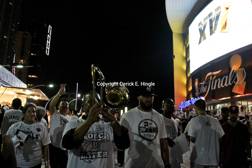 Jun 21, 2012; Miami, FL, USA; Miami Heat fans celebrate outside following the 2012 NBA Finals after defeating the Oklahoma City Thunder in game five at the American Airlines Arena. Miami won 121-106. Mandatory Credit: Derick E. Hingle-US PRESSWIRE