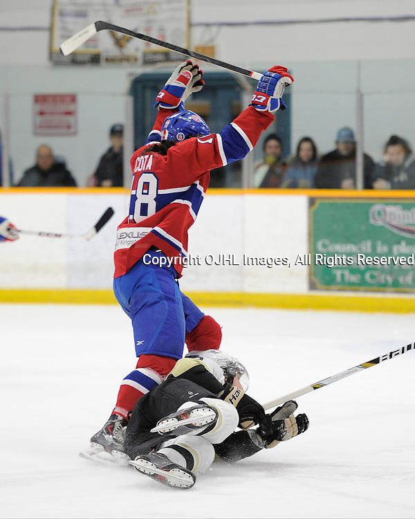 TRENTON, ON - Mar 18 : OJHL North East Conference playoff series round two, Kingston Voyageurs vs Trenton Golden Hawks, Wyatt Cota #18 trips over a Trenton Golden Hawks Hockey player<br /> (Photo by Amy Deroche / OJHL Images)