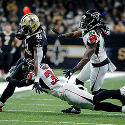Dec 24, 2017; New Orleans, LA, USA; New Orleans Saints running back Alvin Kamara (41) is tackled by Atlanta Falcons cornerback Brian Poole (34) and cornerback Desmond Trufant (21) during the first quarter at the Mercedes-Benz Superdome. Mandatory Credit: Derick E. Hingle-USA TODAY Sports