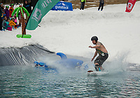Patrick McGrail attempts to skim the pond during Gunstock Mountain's BYODC event on Saturday.     (Karen Bobotas/for the Laconia Daily Sun)