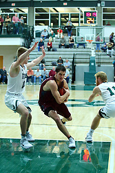 17 November 2017:  Ryan Stevens cuts past Brady Rose during an College men's division 3 CCIW basketball game between the Alma Scots and the Illinois Wesleyan Titans in Shirk Center, Bloomington IL