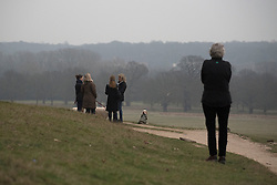 © Licensed to London News Pictures. 20/03/2015. Richmond, UK People watch the cloudy sky darken during the near total eclipse at Richmond Park, Surrey today 20th March 2015. Photo credit : Stephen Simpson/LNP