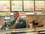Anthony Barr, 2014 draft prospect and newest SUBWAY Famous Fan, poses with his favorite SUBWAY sandwich after unveiling a life-size food statue of himself made of fresh vegetables, Wednesday, May 7, 2014, in New York. Barr joins a roster of fellow Famous Fans that include Robert Griffin III, Justin Tuck, Russell Westbrook, Pele and Michael Phelps. (Photo by Diane Bondareff/Invision for SUBWAY/AP Images)