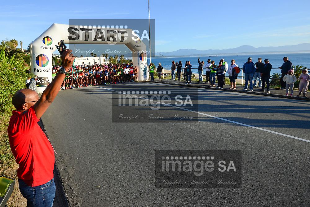 MOSSEL BAY, SOUTH AFRICA - SEPTEMBER 24: Mr Siphamandla Mthethwa (Acting Group Chief Executive Officer (Group CEO) fires the starters gun at the start of the 21,1km half marathon during the PetroSA Marathon finishing at Santos Caravan Park on September 24, 2016 in Mossel Bay, South Africa. (Photo by Roger Sedres/Gallo Images)