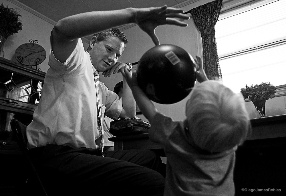 At the Peterson home in The Plains, Ohio, Elder Merrill plays with Bryce, a 19-months-old member of the church, on Wednesday afternoon, May 28, 2008.