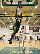 Iowa City West's Myzeah Battie-Gaddy (30) dunks the ball during the 2013 Eastern Iowa All-Star Basketball Game at Iowa City West High School in Iowa City on Wednesday, March 27, 2013. The South (dark) defeated the North (white) 87-79.