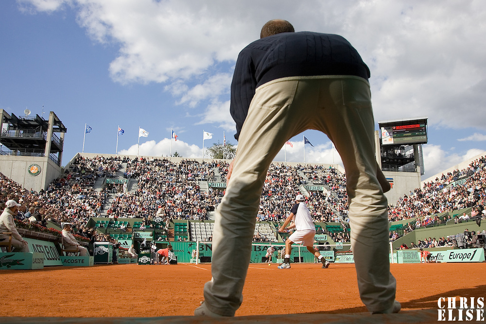 29 May 2007: Andy Roddick of United States of America returns a backhand to Igor Andreev of Russia as a referee watchs during the Men's Singles 1st round match, won 3-6, 6-4, 6-3, 6-4 by Igor Andreev over Andy Roddick, on day three of the French Open at Roland Garros in Paris, France.