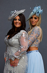 LIVERPOOL, ENGLAND - Thursday, April 6, 2017: Victoria Fergus [L], 34 from Liverpool, wearing a dress from Pink Boutique and Helen Foster [R], 22 from Liverpool, wearing a dress from Asos and a hat from Rodeo in Formby, during The Opening Day on Day One of the Aintree Grand National Festival 2017 at Aintree Racecourse. (Pic by David Rawcliffe/Propaganda)