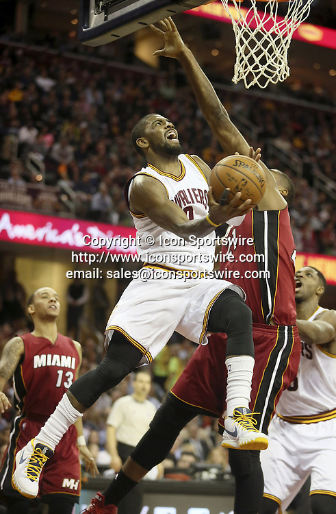Feb. 11, 2015 - Cleveland, OH, USA - The Cleveland Cavaliers' Kyrie Irving drives to the hoop past the Miami Heat's Hassan Whiteside during the second quarter at Quicken Loans Arena in Cleveland on Wednesday, Feb. 11, 2015