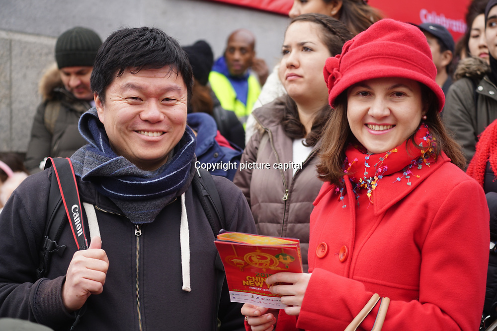 London, UK. 18th Feb 2018. Thousands gather in Trafalgar Square to watch Chinese New Year is Celebrated the Year of a Dog with live performing food and drinks.