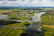 Nederland, Noord-Holland, Gemeente Wormerland, 14-06-2012; Polder Wormer, Jisp en Nek. De verkaveling in het gebied is het resultaat van veenontginning. Links de veenplas De Marken, water van 't Zwet in de voorgrond, lopend naar het dorp Jisp. Links aan de horizon de Beemster met daar achter IJsselmeer..Polder in province North Holland (above Amsterdam) with villages. The division in plots in the area is the result of peat extraction..luchtfoto (toeslag), aerial photo (additional fee required);.copyright foto/photo Siebe Swart