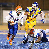 Backup Southaven quaterback Jonah Posey tries to get away from Tupelo's Peter Gray as Tupelo built a 38-0 lead in the first half.