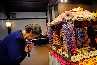 "Noriko Yamashita pays her respects to the baby Buddha at the Buddhist Temple of Salinas. ""Hanamatsuri,"" or flower festival in Japanese, is also known as Buddha's Birthday, and was celebrated on Sunday."
