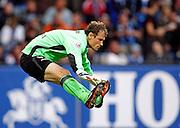 VFB Stuttgart goalkeeper Jens Lehmann does the splits during the Bundesliga match between Hamburger SV and VFB Stuttgart on the 12th September 2009.