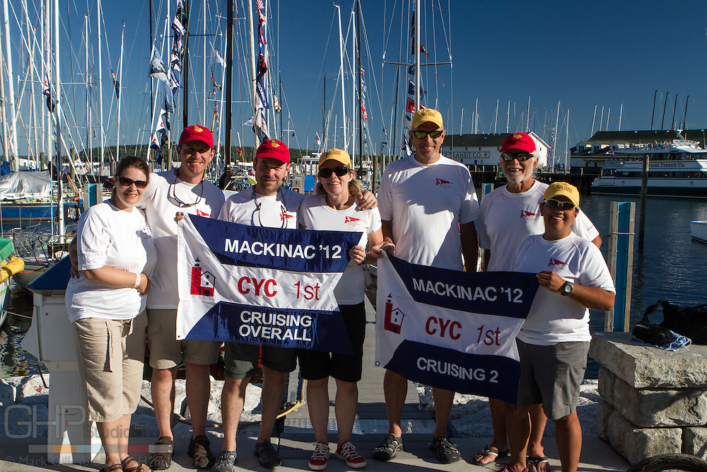 "Crew of Intuion, a 30' S2 9.2a sailboat, show off thier 1st place ""brag flags"" for winning the 104th CYC Race to Mackinac Crusing 2 and Overall Cruising Division."