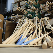 Discarded baseball bats, considered not up to standard,  lay on the floor at Tucci Lumber Company, which makes baseball bats. Norwalk, Connecticut, USA. 27th June 2014. Photo Tim Clayton