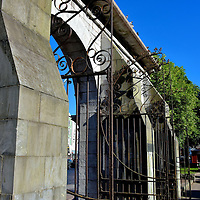 Bishop Lucey Park Gate in Cork, Ireland<br /> Cork became a chartered city in 1185. Part of the 800th anniversary of this event was the opening of Bishop Lucey Park.  While excavating the area, archeologists discovered remnants of the Hopewell Castle and the wall that encircled the city during the Middle Ages. The namesake for this public greenspace is Cornelius Lucey, the Catholic Bishop of Cork from 1951 until he retired in 1980. This is the park&rsquo;s arched gate.  When it was constructed in 1860, it was the entrance to the city&rsquo;s corn market on Angelesea Street.