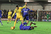 Callum Kennedy of AFC Wimbledon watches as Tom Elliott of AFC Wimbledon tumble during Sky Bet League 2 match between AFC Wimbledon and Bristol Rovers at the Cherry Red Records Stadium, Kingston, England on 26 December 2015. Photo by Stuart Butcher.