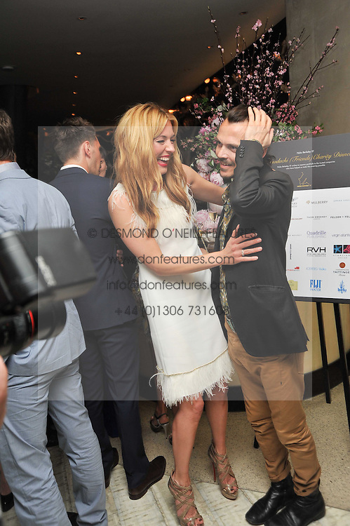 CAT DEELEY and MATTHEW WILLIAMSON at the second night of the Tomodachi (Friends) Charity Dinners hosted by Chef Nobu Matsuhisa in aid of the Japanese committee for UNICEF held at Nobu Berkeley, Berkeley Street, London on 5th May 2011.