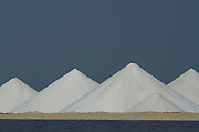 Salt mounds and Evaporation Ponds.<br /> Sea Salt Production Plant started in the 1600's and worked by African Slaves.<br /> Cargill Solar Salt Works<br /> Pekelmeer lagoon<br /> BONAIRE, Netherlands Antilles, Caribbean