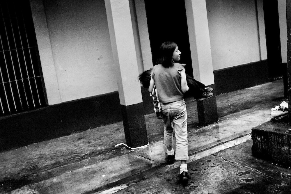 Friday, May 11, 2007. Quetzaltenango, Guatemala - .Karla Campos carries Luisa Roldán to her room for a nap. The women and children of the shelter have learned to trust each other which affirms a new start in life and in relationships.