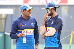 July 6, 2018 - Sri Lanka - Sri Lankan cricket captain Dinesh Chandimal(R) and Batting Coach Thilan Samaraweera(L) speak at a practice session at the R.Premadasa Stadium in Colombo on July 6, 2018.Sri Lanka and South Africa will play two Tests, five 50-over One-Day Internationals (ODIs), and one T20 in Sri Lanka between July 12 and August 14. The first Test between South African and Sri Lanka will be played on July 12 at the Galle International Cricket Stadium in Galle (Credit Image: © Lahiru Harshana/Pacific Press via ZUMA Wire)