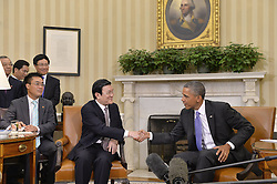 60197536  <br /> U.S. President Barack Obama (1st R) meets with his Vietnamese counterpart Truong Tan Sang (2nd R) in the Oval Office of the White House in Washington D.C., capital of the United States, <br /> Thursday, 25th July 2013<br /> Picture by imago / i-Images<br /> UK ONLY