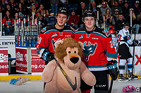 KELOWNA, CANADA - DECEMBER 2: Conner Bruggen-Cate #20 and Kyle Topping #24 of the Kelowna Rockets pose with a teddy bear during the annual teddy bear toss against the Kootenay Ice on December 2, 2017 at Prospera Place in Kelowna, British Columbia, Canada.  (Photo by Marissa Baecker/Shoot the Breeze)  *** Local Caption ***