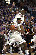 Kansas State guard Akeem Wright (34) pulls down a rebound in front of teammate Dramane Diarra (21) against Oklahoma State at Bramlage Coliseum in Manhattan, Kansas, February 4, 2006.  The Cowboys  defeated K-State 63-61.