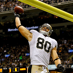 September 23, 2012; New Orleans, LA, USA; New Orleans Saints tight end Jimmy Graham (80) dunks over the goal post after scoring a touchdown during the third quarter of a game against the Kansas City Chiefs at the Mercedes-Benz Superdome. The Chiefs defeated the Saints 27-24 in overtime. Mandatory Credit: Derick E. Hingle-US PRESSWIRE